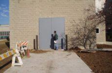 A pair of outdoor sound control doors