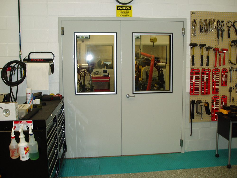 Two white acoustic doors with windows