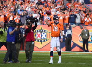 peyton manning raising ball